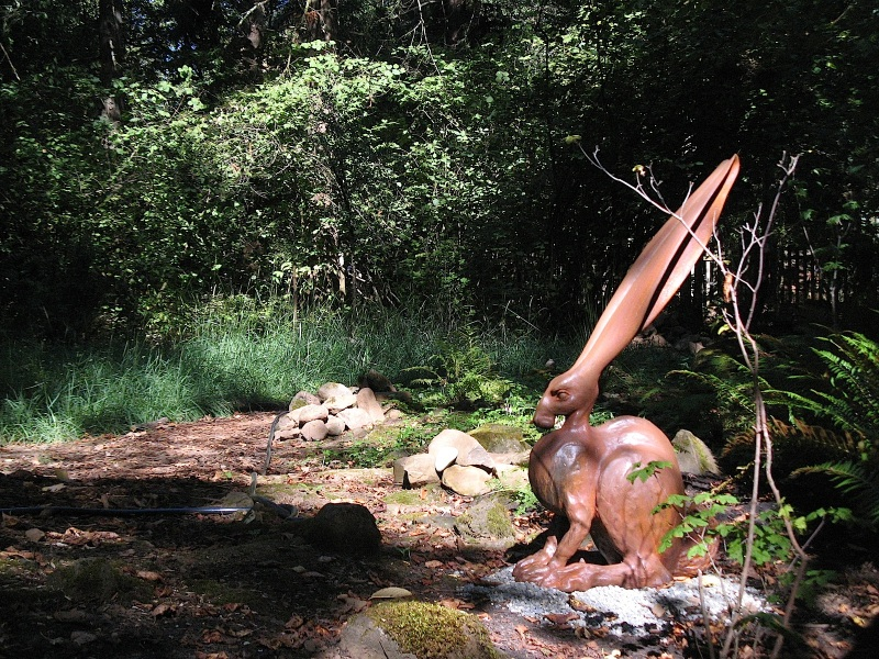 Large scale ceramic sculpture by Steve Eichenberger, in an Oregon native plant garden.